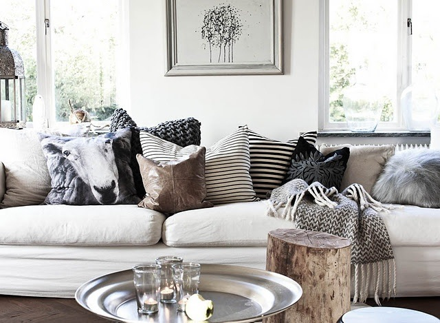 Tonally alike cushions with varying texture and print