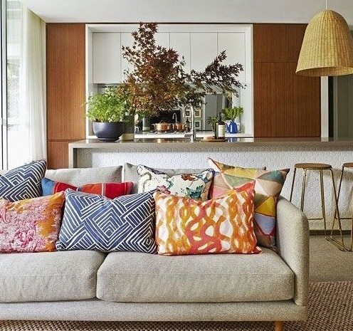 Too much of a good thing? Too many cushions can make it hard to actually sit on the sofa. Over-mixing of pattern creates a busy look