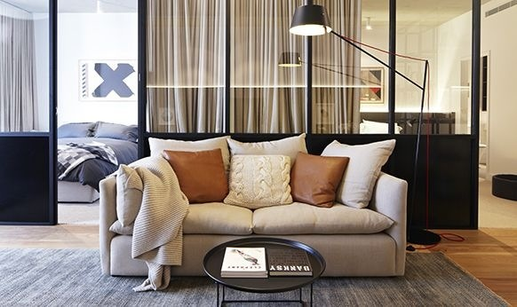 Warm, cosy and inviting. The Jardan Cleo couch with simple leather and cable knit accessories