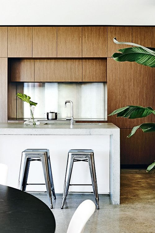Timber, white and galvanised steel combine successfully in this modern kitchen Below, colourful pops against marble and timber. I especially love the olive stools contrasting with the copper pendant and marble slab