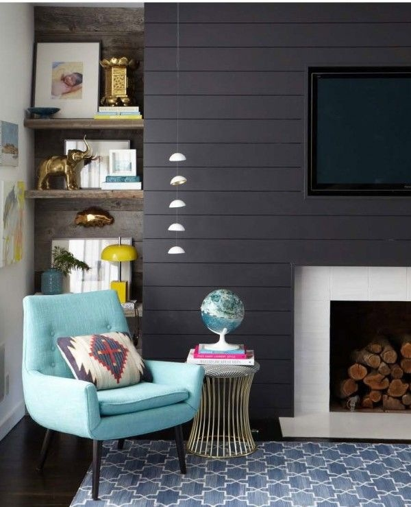 Depth and character in a contrasting dark wall. Design by Emily Henderson. Photography Bethany Nauert