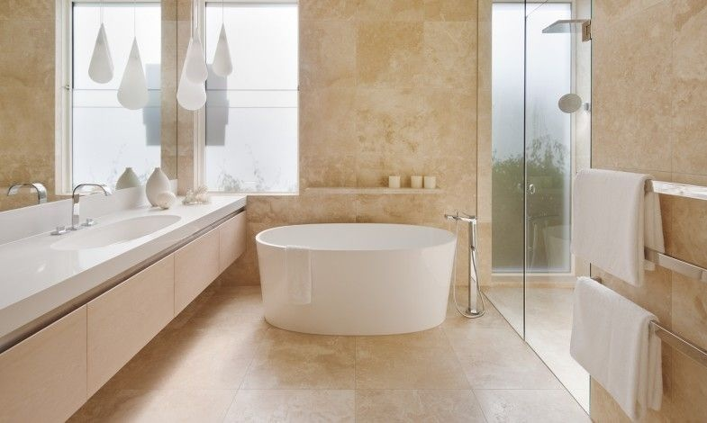 Travertine is a beautiful soft choice for bathroom flooring.
