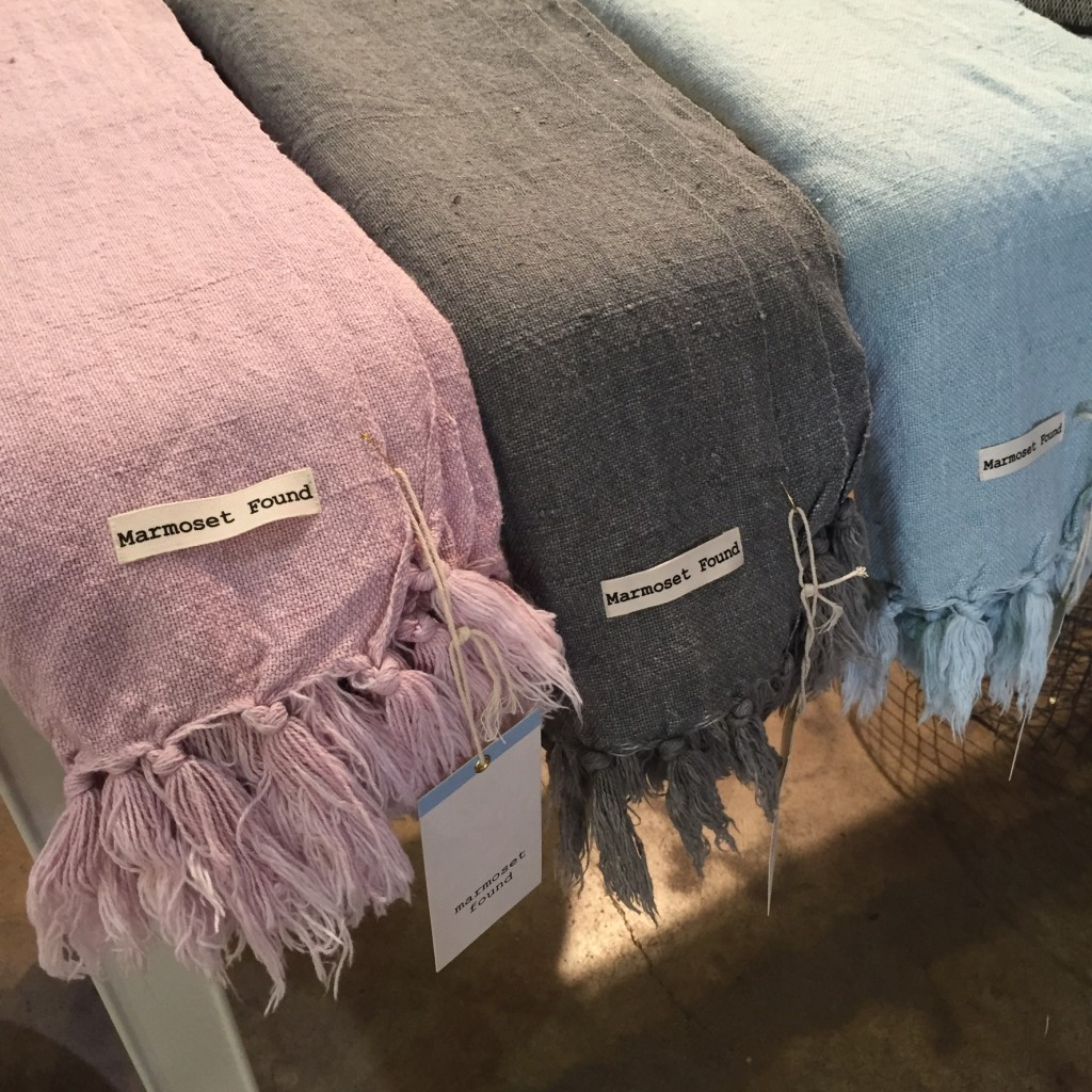 Lilac, sky blue an charcoal feature in the new range of throws and cushions from Marmoset Found