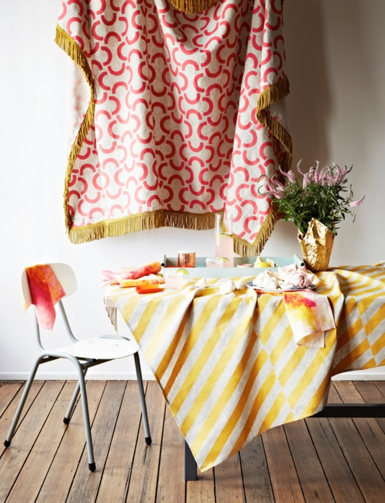 Golden Arches Oatmeal throw in melon with gold fringing