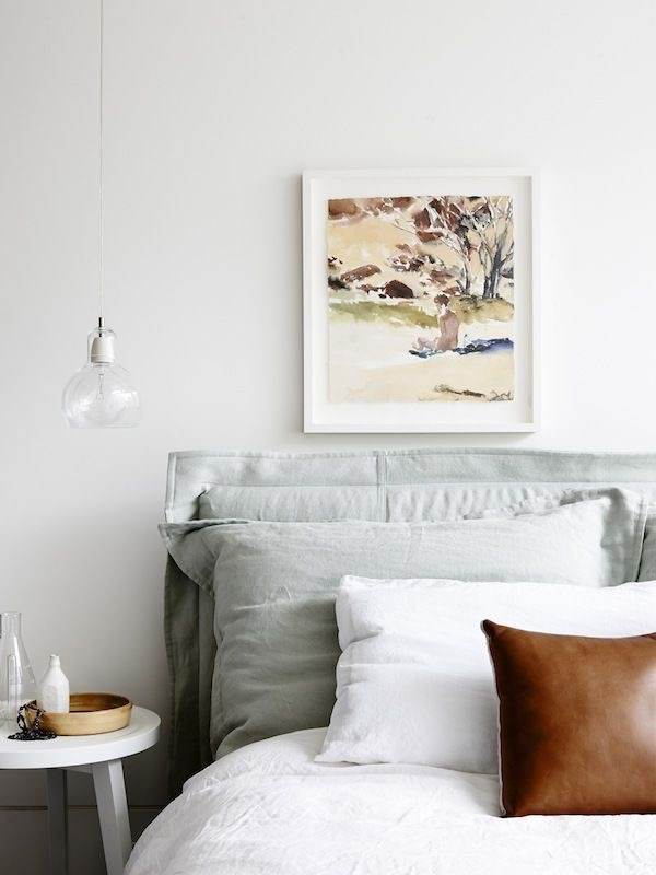 This stunning bedroom scene created in the apartment home of Eddie Kaul and Richa Pant by Hecker Guthrie. Photography by Eve Wilson. Mega Bulb pendant lighting looking gorgeous with these soft bedroom linens and watercolour by Nicolas Harding.