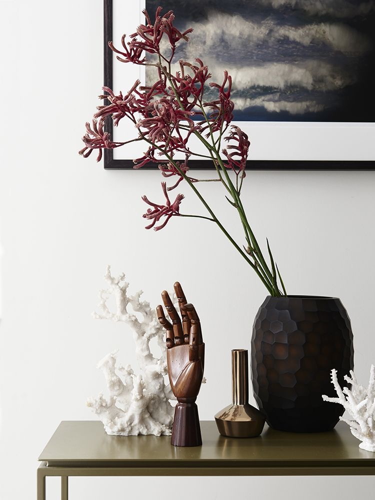 Varying heights, shapes and textures create an interesting yet coherent display. Hall House by Sisalla Interior Design. Styling by Andy Moore. Photography by Eve Wilson.