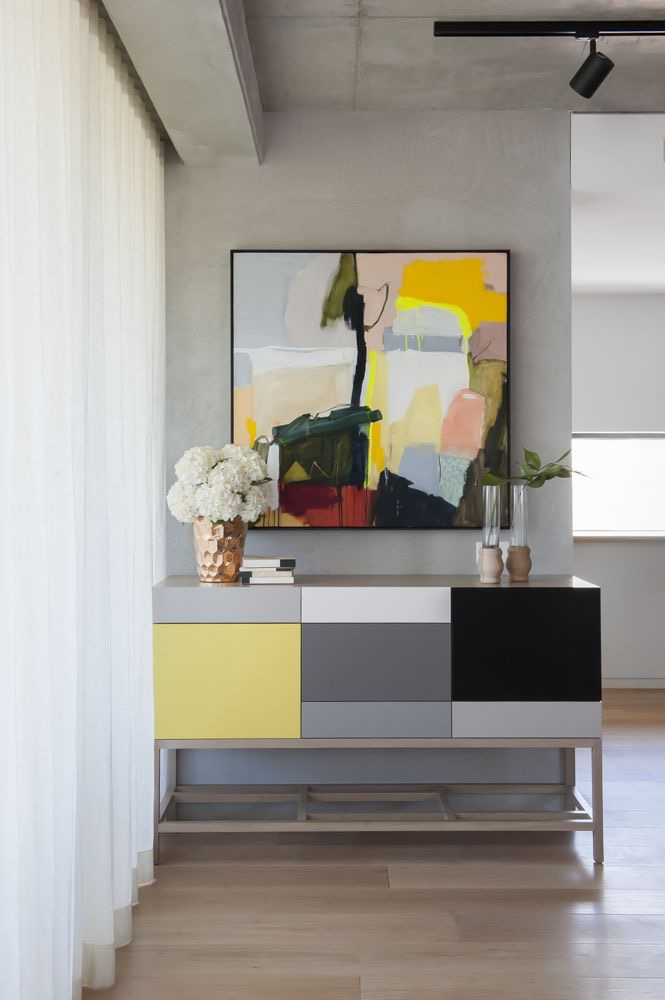 Beautiful console styling by Peschek Interiors, featuring the Echo cabinet by Zuster and artwork by Waldemar Kolbusz. Photography by Nicole England.