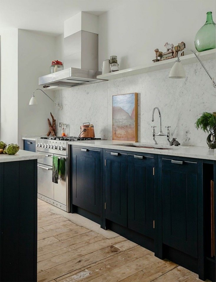 Skye Gyngell's kitchen by British Standard. Carrara marble top and splashback, Farrow & Ball Hague Blue cabinets and double copper sink. Photography by Alex Hamilton