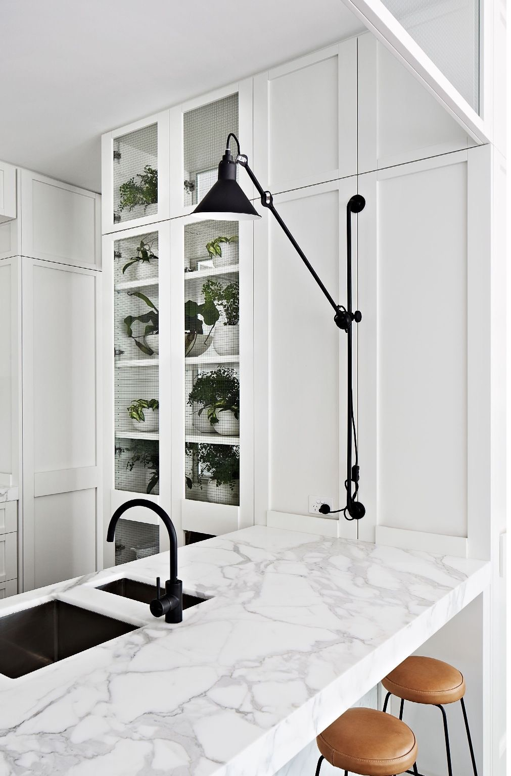 Black and marble kitchen by Hecker Guthrie