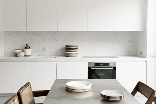 Integrated stone sink features in this minimalist kitchen by Belgian architect Nicolas Schuybroek.