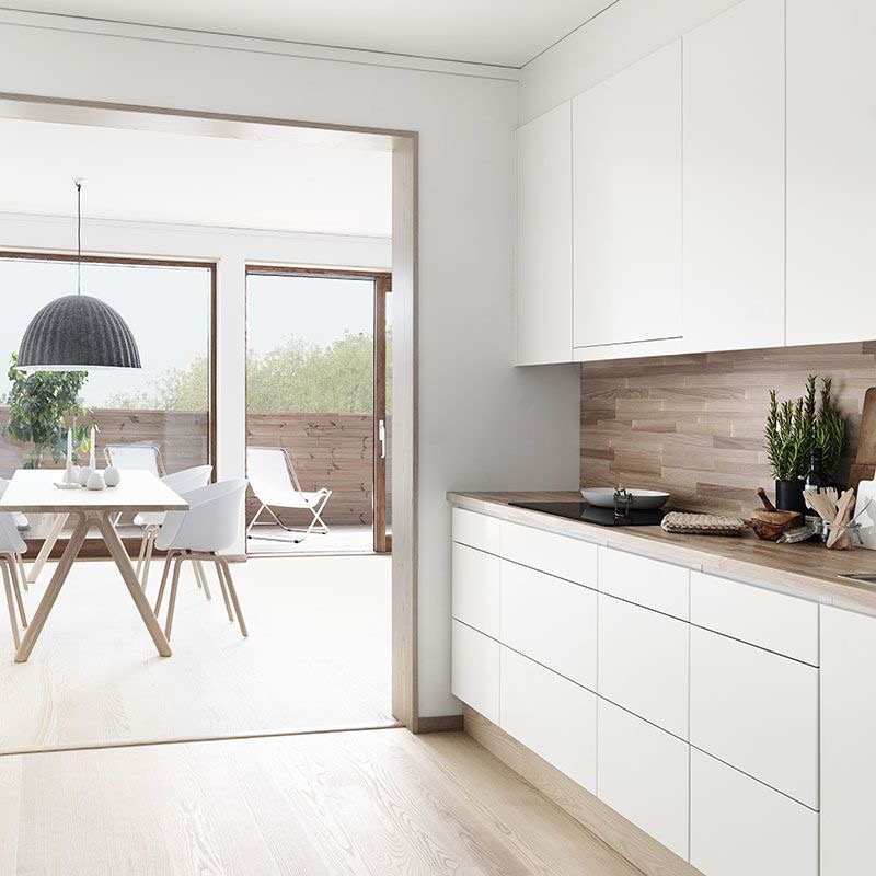 "Timber benchtops in this Swedish kitchen via folk hem.se. Photography by Petra Bindel. Dining zone features the Hay ""About a chair' chairs and Muuto 'Under the Bell' pendant."