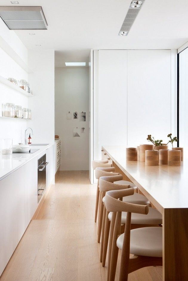 Kitchen sink is positioned off the main island and dining area in the Alfred St residence by Studio Four. Photography by Shannon McGrath.