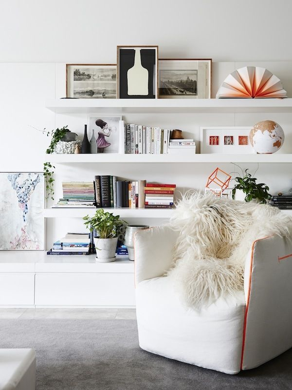 Beautifully full and interesting shelf styling in the Carlton apartment by Hecker Guthrie. Photography by Eve Wilson